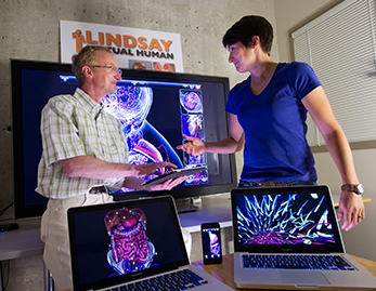 Dr. Heather Jamniczky (right) and Dr. Chrsitian Jacob showing 3D anatomy software created at the University of Calgary