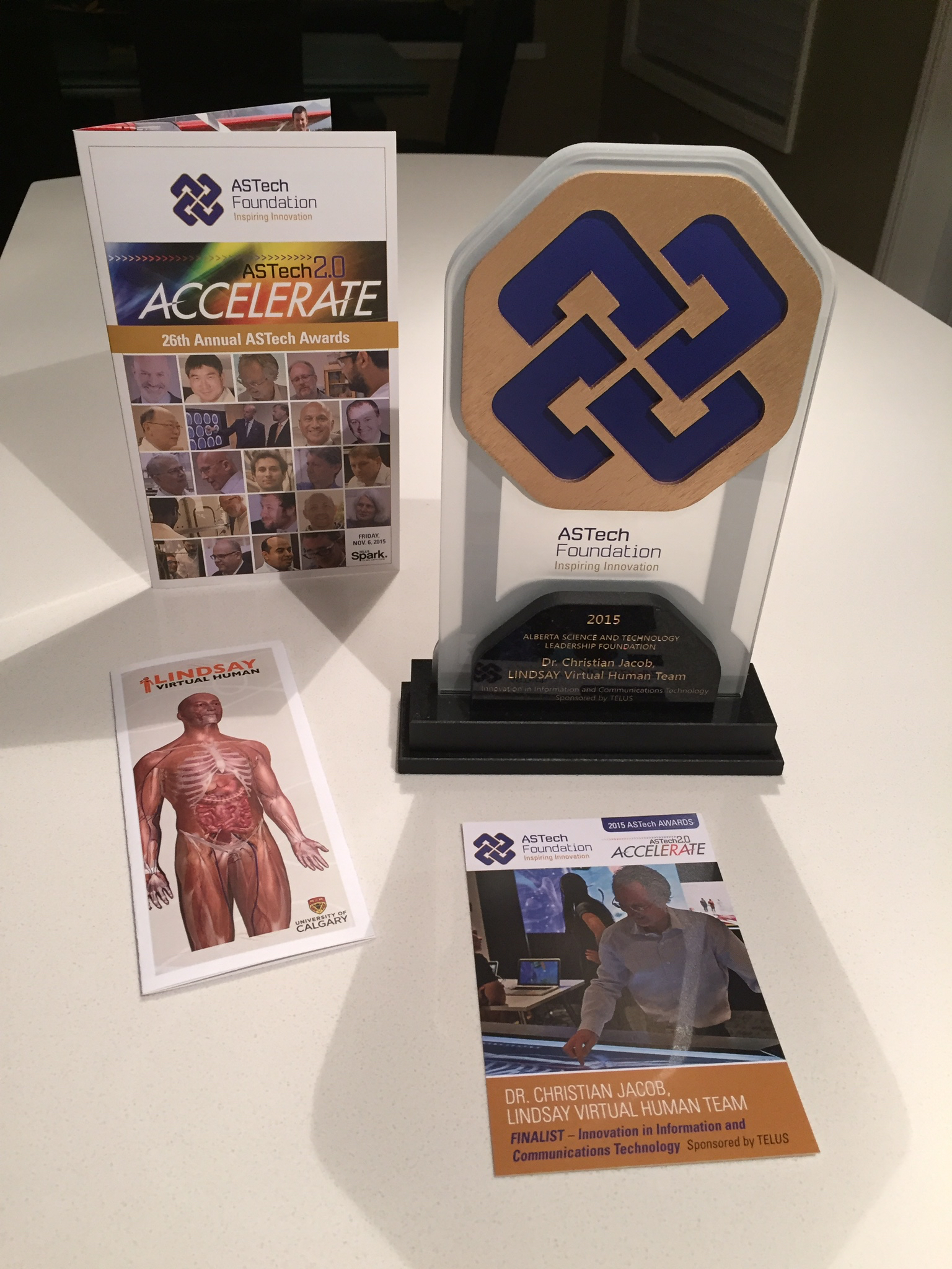 ASTech brochure, trophy, and plaque notes with LINDSAY brochure